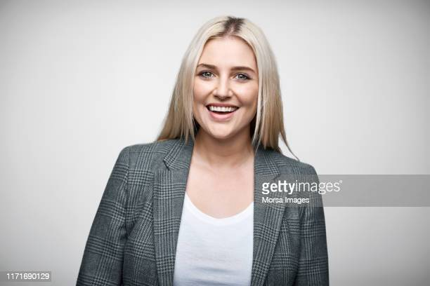 portrait of confident beautiful businesswoman - grey blazer stock pictures, royalty-free photos & images