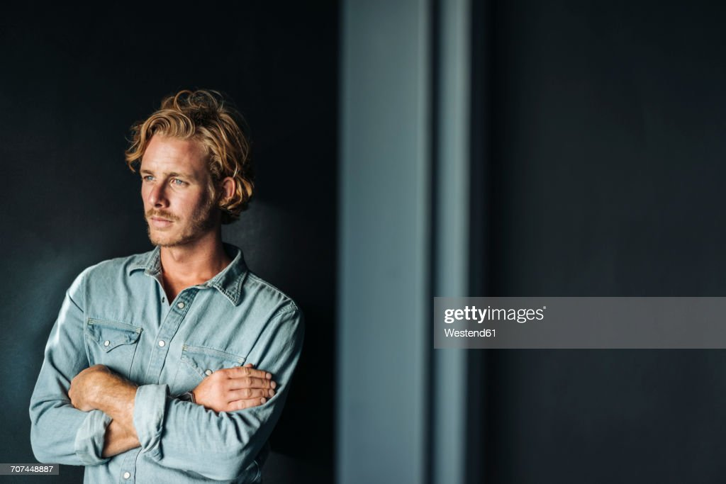Portrait of confident blond man wearing white shirt : Stock-Foto