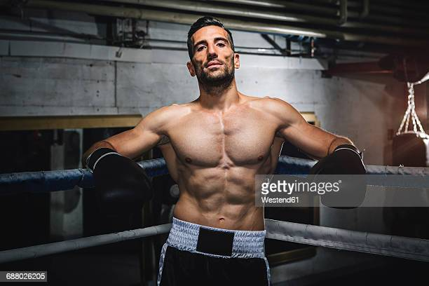 Portrait of confident boxer in boxing ring