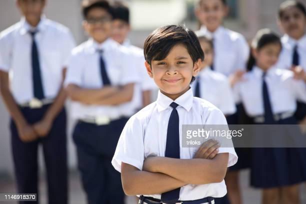 portrait of confident boy in school uniform - uniform stock pictures, royalty-free photos & images