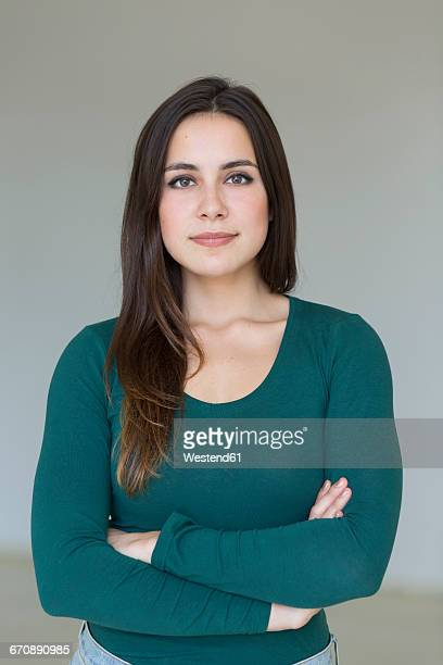 portrait of confident brunette young woman - long sleeved stock photos and pictures