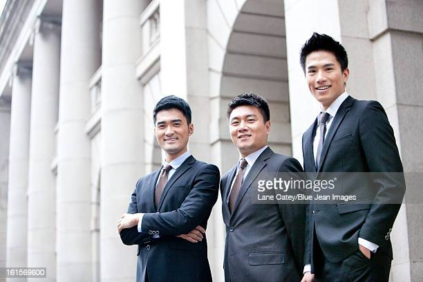 Portrait of confident business team in front of a building, Hong Kong