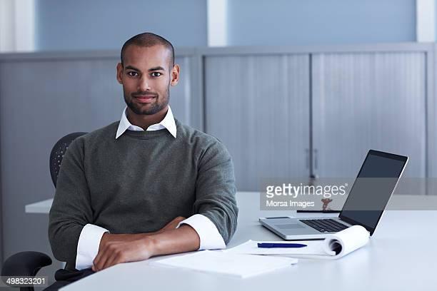 Portrait of confident businessman at desk