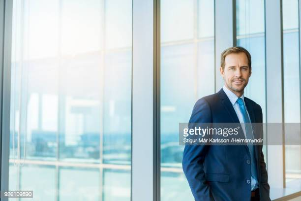 portrait of confident businessman at office - full suit stock pictures, royalty-free photos & images