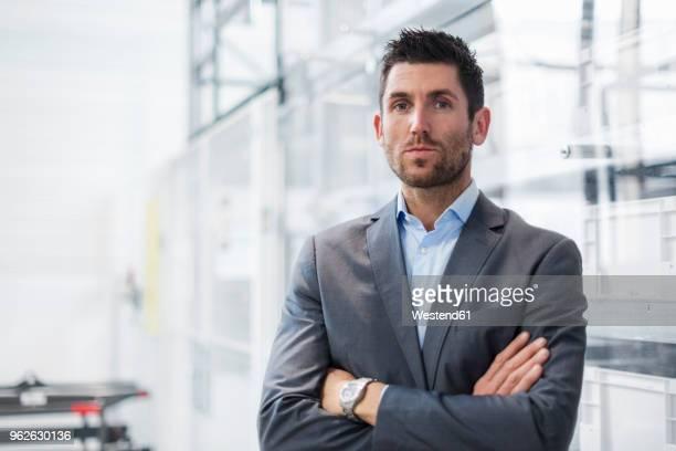 Portrait of confident businessman in modern factory
