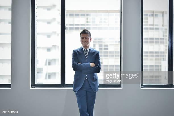 portrait of confident businessman in office - suit ストックフォトと画像