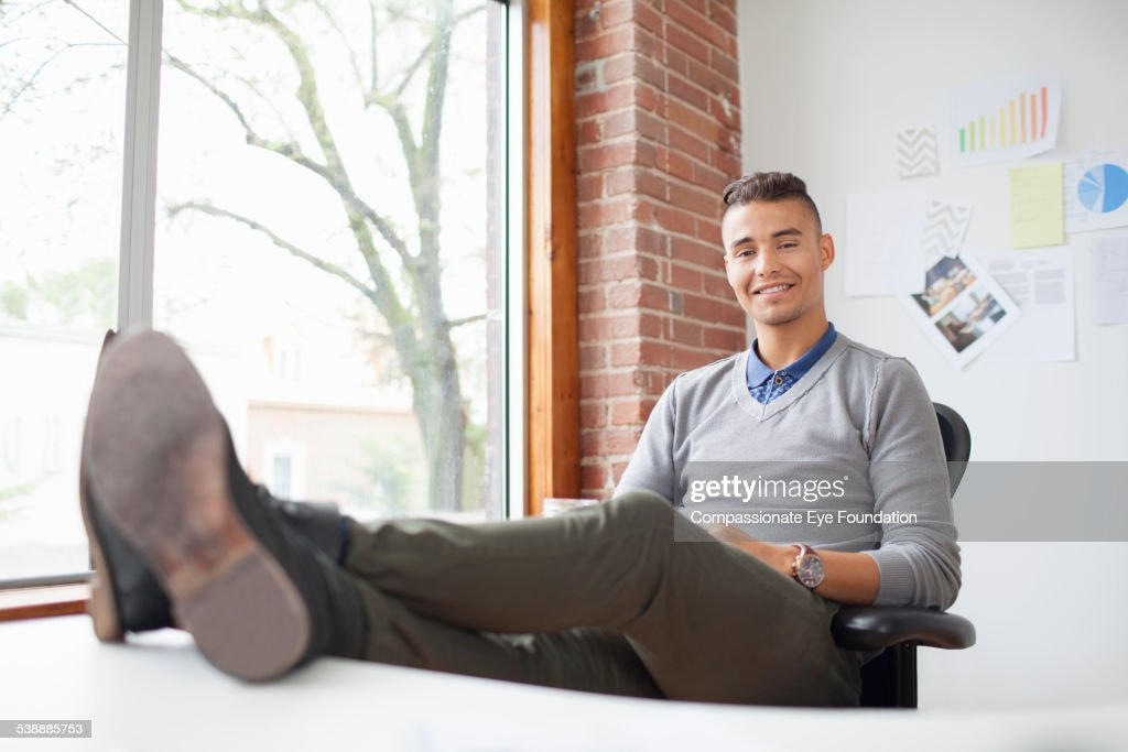 Portrait of confident businessman in office : Stock Photo