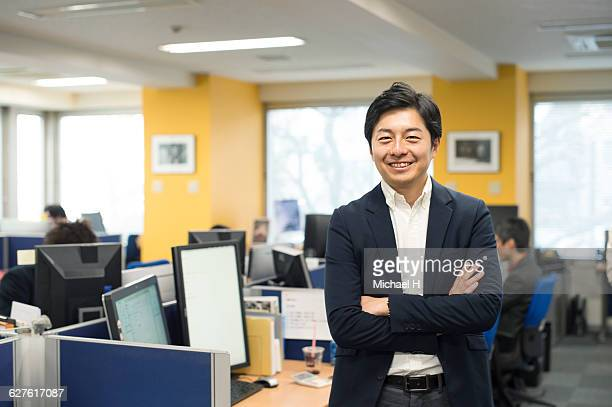 Portrait of confident businessman in office