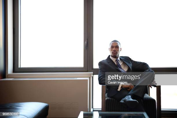 portrait of confident businessman in office - one man only stock pictures, royalty-free photos & images