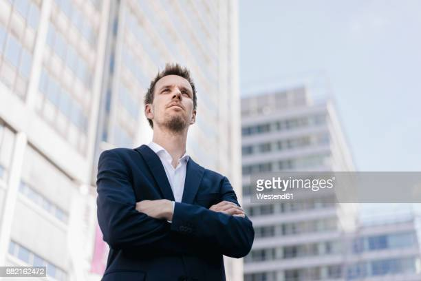 portrait of confident businessman in the city - low angle view stock pictures, royalty-free photos & images
