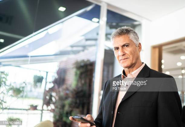 portrait of confident businessman - chairperson stock pictures, royalty-free photos & images