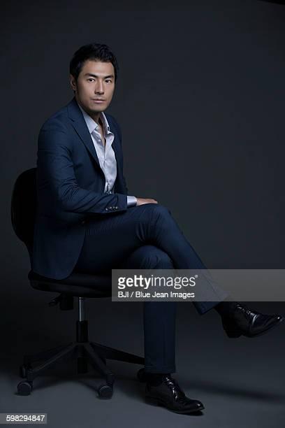 portrait of confident businessman - オープンネック ストックフォトと画像