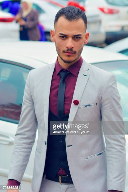 Portrait Of Confident Businessman Standing By Car