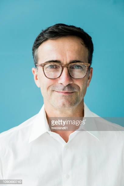 portrait of confident businessman wearing glasses - one mature man only stock pictures, royalty-free photos & images