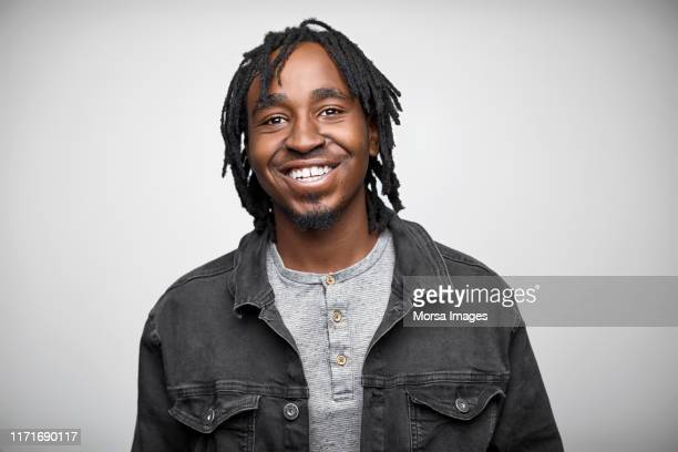 portrait of confident businessman wearing jacket - dreadlocks stock pictures, royalty-free photos & images