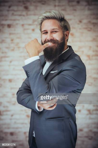 Portrait of confident businessman with mobile phone