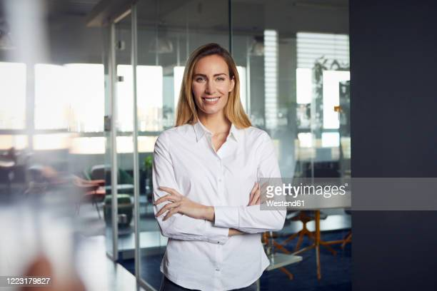 portrait of confident businesswoman in office - blouse stock pictures, royalty-free photos & images