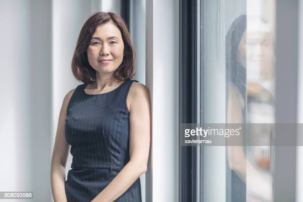 portrait of confident businesswoman in office - looking at camera stock pictures, royalty-free photos & images