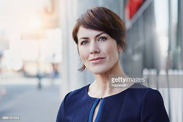 Portrait of confident businesswoman outdoors