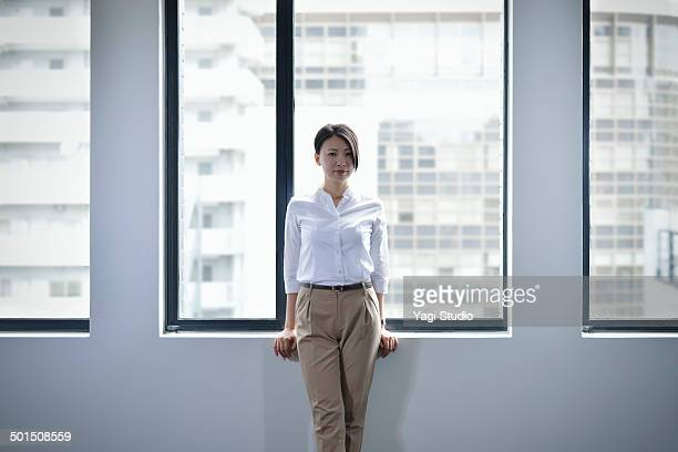 portrait of confident businesswoman - white pants stock pictures, royalty-free photos & images