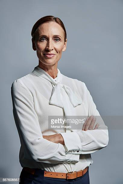 portrait of confident businesswoman - blouse stockfoto's en -beelden