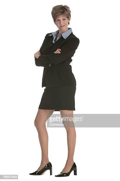 Portrait of confident businesswoman smirking