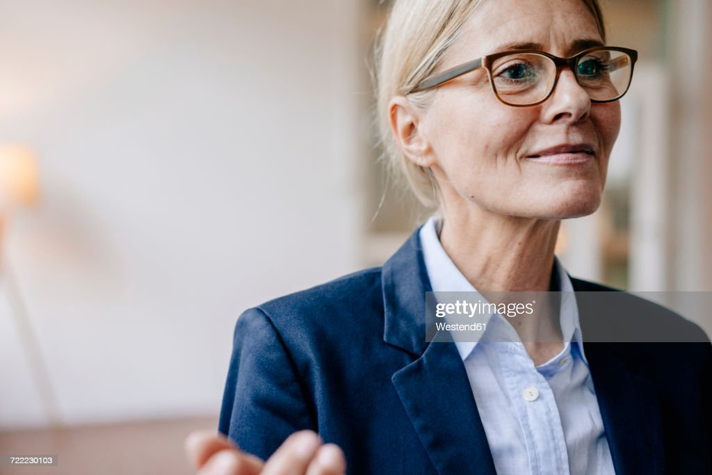 Portrait of confident businesswoman wearing glasses : Stock Photo