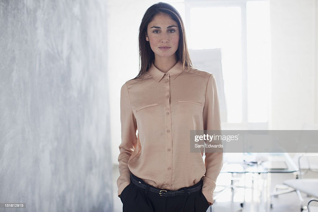 Portrait of confident businesswoman with hands in pockets : Stock Photo