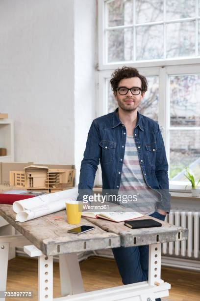 Portrait of confident casual man in office