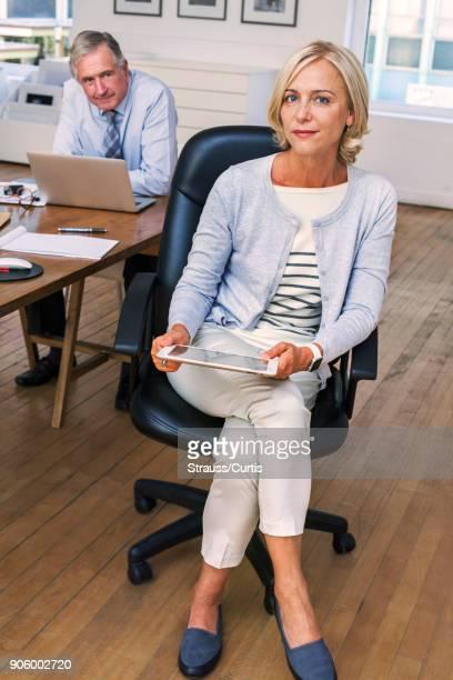 Portrait of confident Caucasian businesswoman holding digital tablet