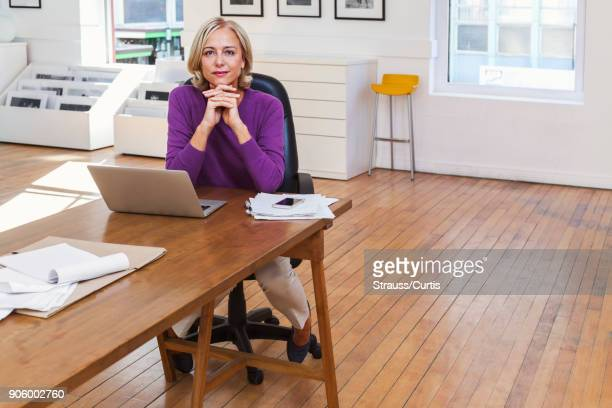 portrait of confident caucasian businesswoman - museum curator stock pictures, royalty-free photos & images