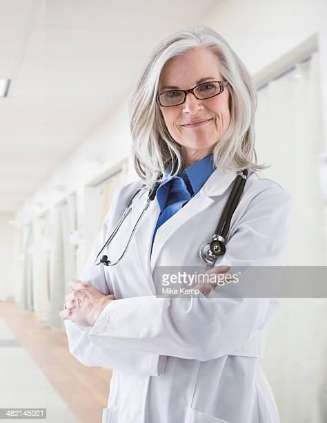Portrait of confident Caucasian doctor in corridor
