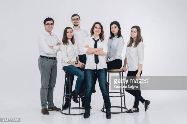 Portrait of confident Caucasian men and women