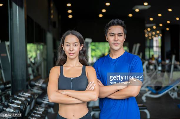 portrait of confident cheerful of beautiful physical fitness exercise instructors in gym. professional occupation and healthly lifestyle concept. - professional occupation photos et images de collection