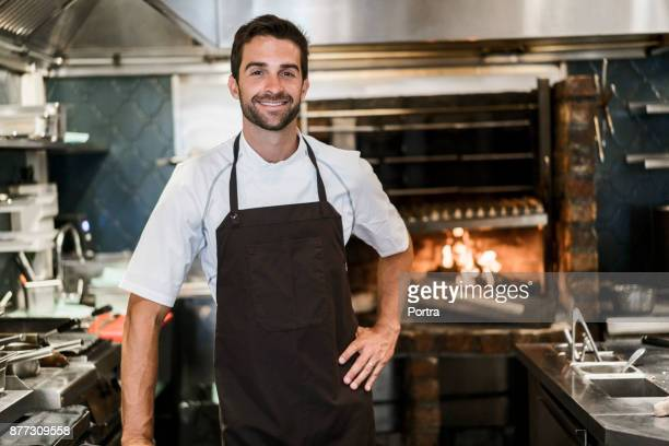 Portrait of confident chef in commercial kitchen