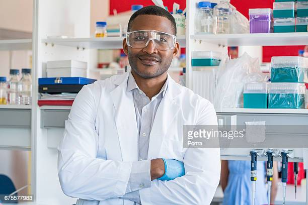 Portrait of confident chemist in laboratory