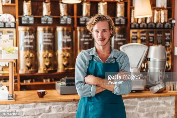 Portrait of confident coffee roaster in his shop