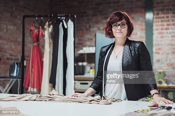 Portrait of confident designer in bridal shop