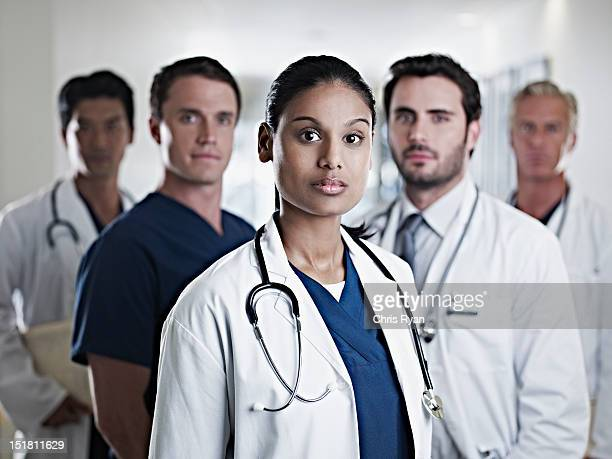 portrait of confident doctors and nurses - group of doctors stock pictures, royalty-free photos & images