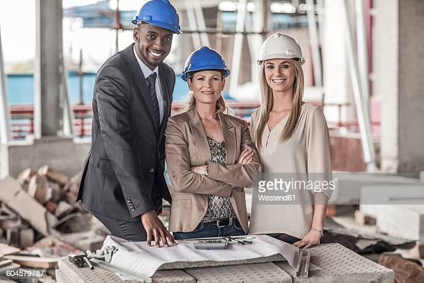Portrait of confident executives in construction site