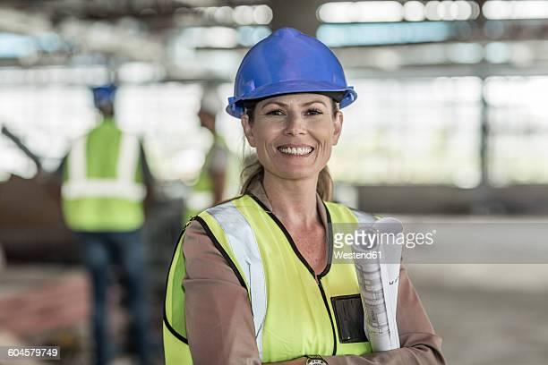 Portrait of confident female architect in construction site