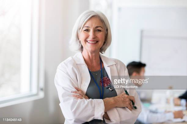 portrait of confident female doctor - administrator stock pictures, royalty-free photos & images
