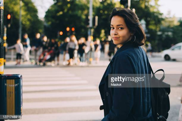 portrait of confident female explorer on road in city - incidental people stock pictures, royalty-free photos & images