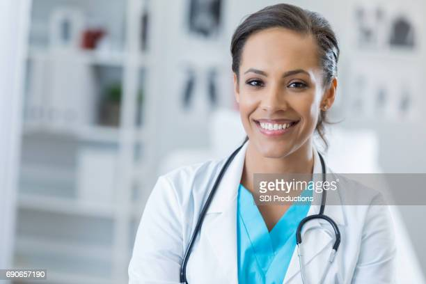 portrait of confident female healthcare professional - female doctor stock photos and pictures