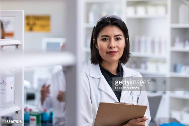 portrait of confident female scientist - microbiologist stock pictures, royalty-free photos & images