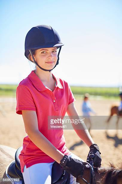 portrait of confident girl on horse - riding hat stock pictures, royalty-free photos & images
