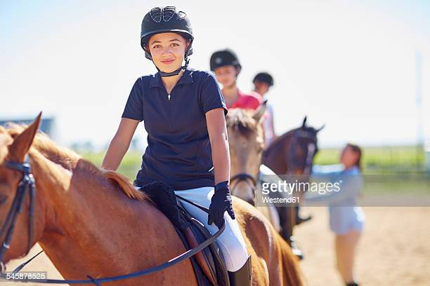 portrait of confident girl on horse - equestrian helmet stock pictures, royalty-free photos & images