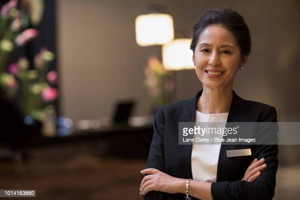 portrait of confident hotel manager - nameplate stock pictures, royalty-free photos & images
