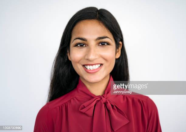 portrait of confident indian businesswoman in early 20s - headshot stock pictures, royalty-free photos & images