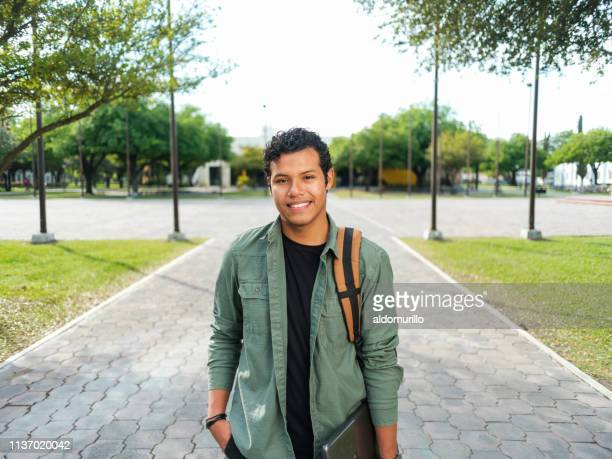 portrait of confident latin male student - medium shot stock pictures, royalty-free photos & images